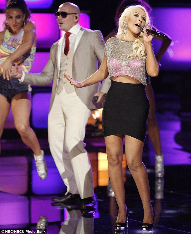 Shedding the pounds: Christina Aguilera showed off her slimmed down figure for a performance with Pitbull during The Voice season four finale on Tuesday