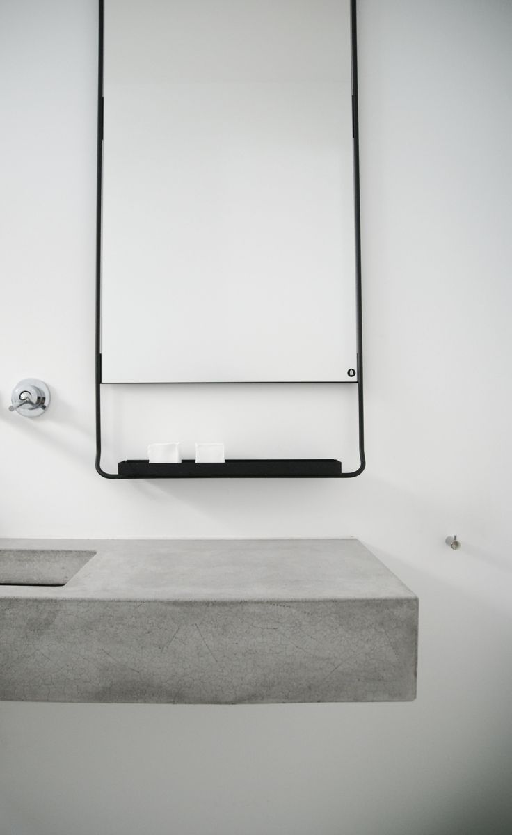 white concrete and black bathroom