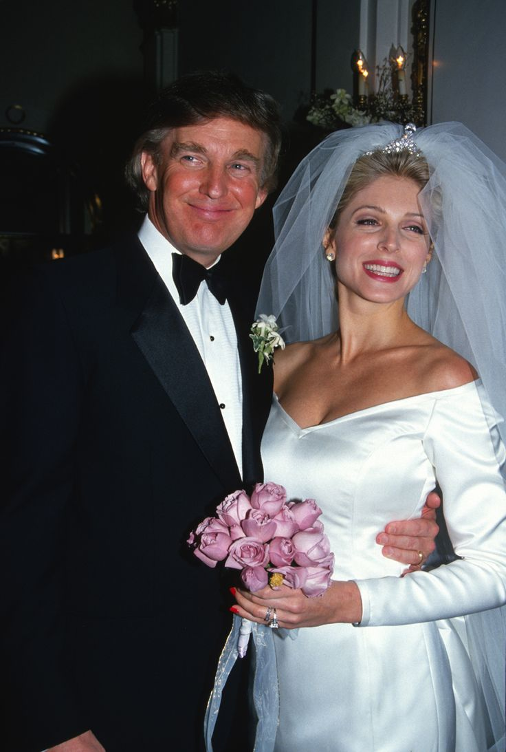 1993 Bridal gowns of the '90s were more sleek and simple than the styles popular in the 1980s, but brides still loved a small touch of poof and drama, which is evident in this photo from the wedding of Marla Maples and Donald Trump.