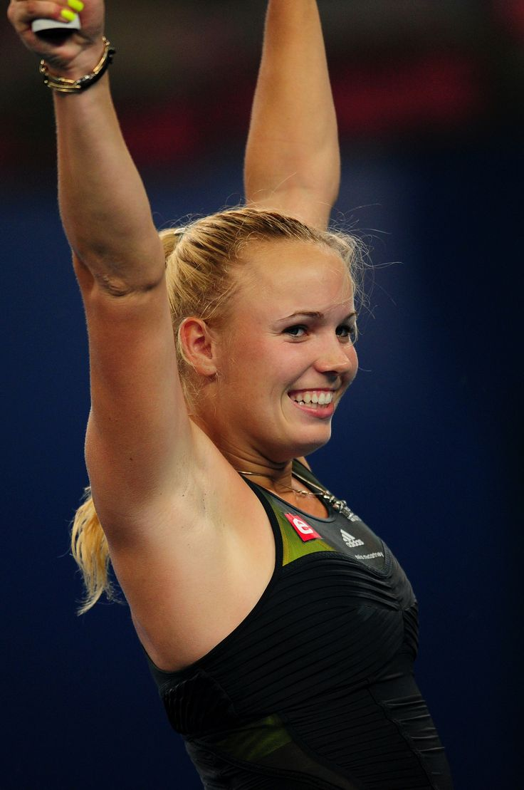 https://flic.kr/p/qDZx5B | TENNIS-WTA-ATP-CHN | Caroline Wozniacki of Denmark jubilates after winning her third round women's match against Petra Kvitova of Czech Republic and become the world's number one rank women's player, in the China Open tennis tournament at the National Tennis Center in Beijing on October 7, 2010. Wozniacki  beat Kvitova 6-2, 6-3.  AFP PHOTO/Frederic J. BROWN