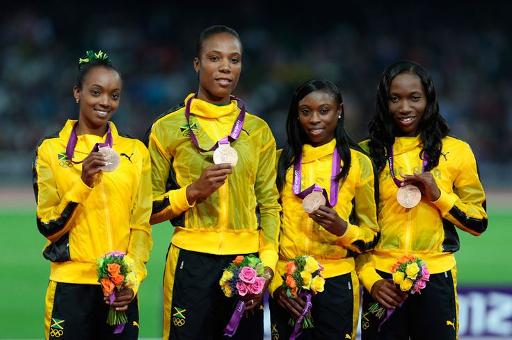 London 2012 - Jamaican athletes (L to R) Christine Day, Rosemarie Whyte, Shericka Williams, and Novlene Williams-Mills display their bronze medals during the podium celebration for the women's 4x400m relay on August 11, 2012.  2012 Getty Images