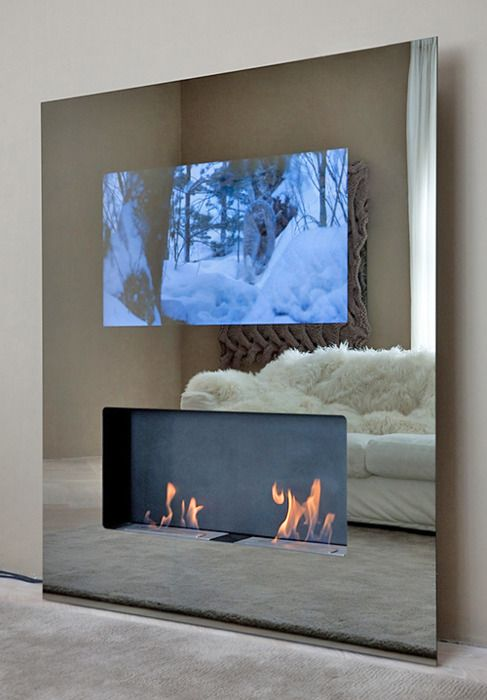 mirrored wall with fireplace and tv - very sleek!