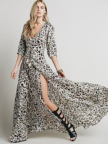 Wild One Gown | Spectacular leopard print maxi with a full flowing skirt and front slit.  Button closures along the bust, which if left unbuttoned can transform this dress into a delicate duster.  Stretchy waistband that allows for ruching.   *By Spell  *For as long as sisters Elizabeth and Isabella can remember they've been enamored by the feeling created when you combine feathers, leather, and turquoise. In the 1960s and '70s their father was a leather craftsman and their mother was a ...
