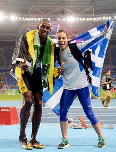 Greece's Golden Athlete Katerina Stefanidi celebrates her Gold medal win on the track at Rio De Janeiro with Jamaican Usain Bolt, who won his 3rd Gold in Rio Olympic Games .