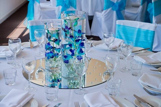 #orchids #blue #centrepiece #vases #mirror #wedding #weddingreception #3tieredvases