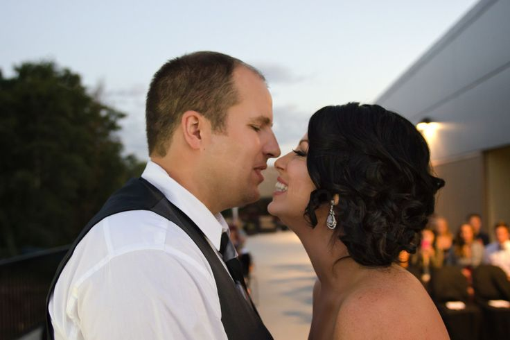 The first second after the kiss is a moment of  sheer joy for these newlyweds