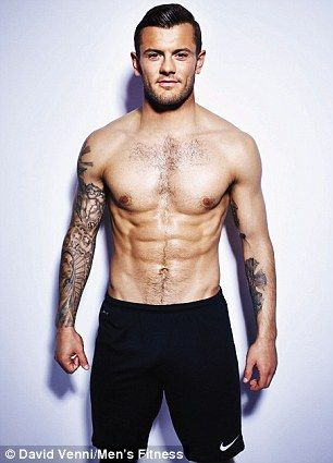 Wilshere shows off his physique...