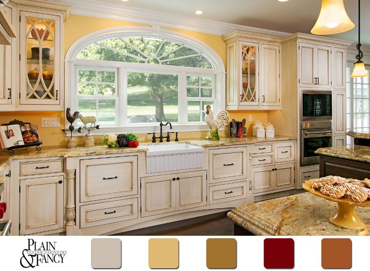 French Country Kitchen With Yellow Walls And Antiqued Cabinets Love The Big Window Ole Farmhouse Sink Mix Of Marigold White
