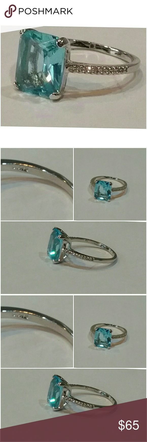 Genuine Aqua Marine and White Sapphire Ring Sz 10 Finding a 6ct Aquamarine in such clarity and color is hard to do. Aquamarine is one of 4 previous gems. Diamond, Sapphire and Ruby are the other 3. This stone enhances the wearers courage and intuition. Amongst other things. Set in 925 stamped Solid Sterling Silver. Tiny sapphires sparkle on each side of the band.  Please see all pictures for details. Brand New. Never Worn. Wholesale Price. Msrp 745.00 Jewelry Rings