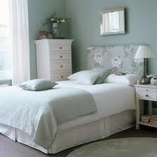 Classic White Free Standing In A Pretty Pale Green Bedroom.