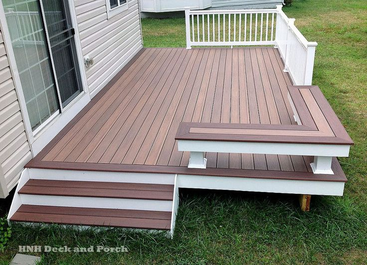 low maintenance decks, decks, outdoor furniture, outdoor living, Vinyl patio deck using Wolf PVC Decking with amberwood flooring and rosewood border and Longevity white PVC railing