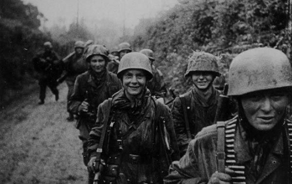 A Famous Photo (from a Newsreel) of 10./Fallschirmjäger Regiment 6 in Normandy full of young faces, including Gefreiter Georg Schober (center looking directly at camera).   I never knew what Unit of FJR6 they belonged to till I read 'Lions Of Carentan' which had another photo from the newsreel with the man at the front right cut off.