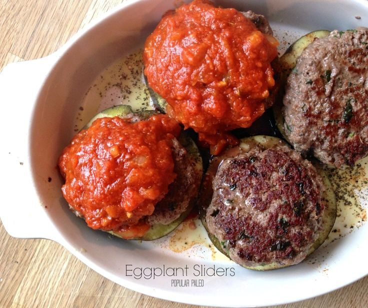 Fun recipe for eggplant on www.PopularPaleo.com | Layer herbed burgers on eggplant and top with zesty (and fast) tomato sauce. So good!