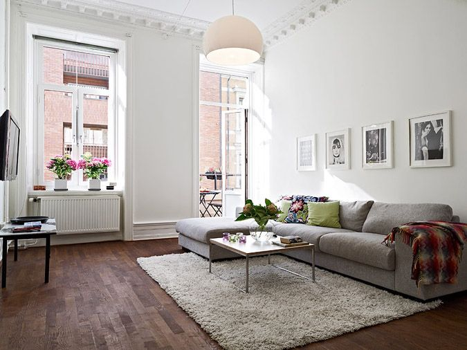 White Warm Wood Floors Grey Couch Lots Of Light Plush Rug
