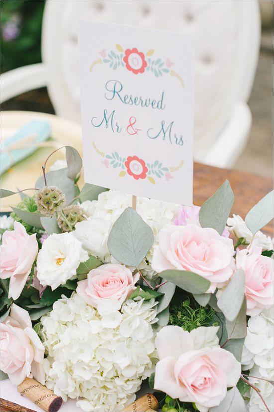 stunning floral centerpiece from wedding designed by Luxe Event Productions #weddingreception #reservedsign #weddingchicks http://www.weddingchicks.com/2014/04/03/luxe-event-productions/