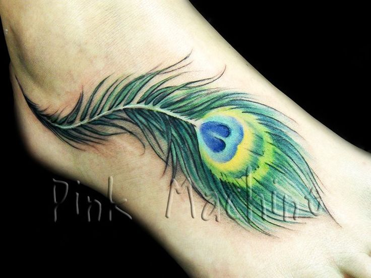 peacock feather tattoo... like the movement of this one