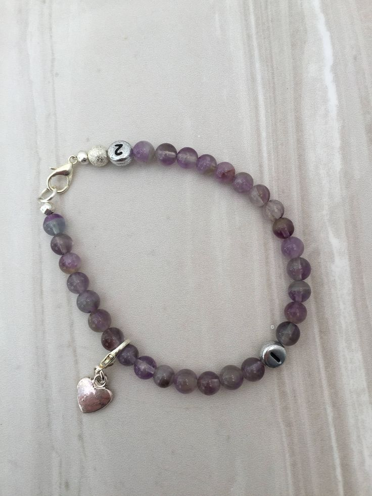 A personal favourite from my Etsy shop https://www.etsy.com/uk/listing/535669897/amethyst-weight-loss-tracker-bracelet