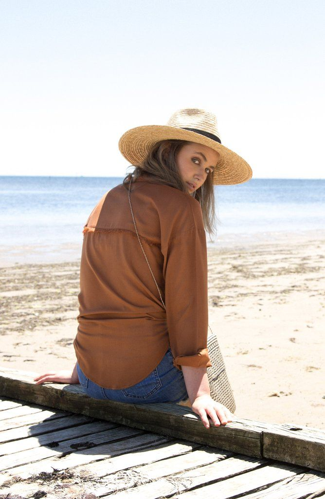 The Knot Top - Desert Brown - is the staple of knotted shirts. Made in a flattering rayon fabric, it features fringed details on pockets and back... Made with love in Bali.