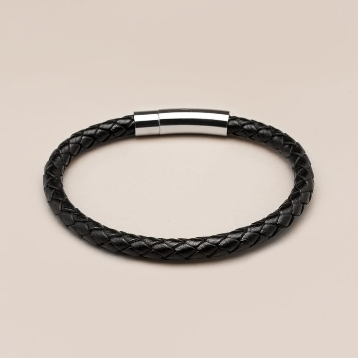 This Genuine Black Leather Braided Bracelet has a beautiful contrast of leather and steel that provides the best of buttery braids and a cool steel clasp. It's the ideal accessory for minimal manliness, with jeans or a suit.