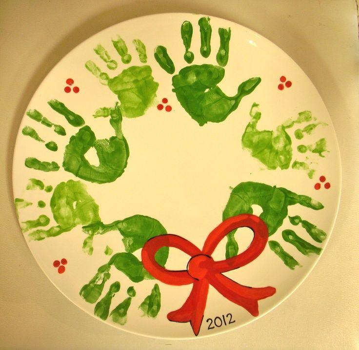 christmas handprint crafts | Handprint wreath painted pottery | Christmas crafts