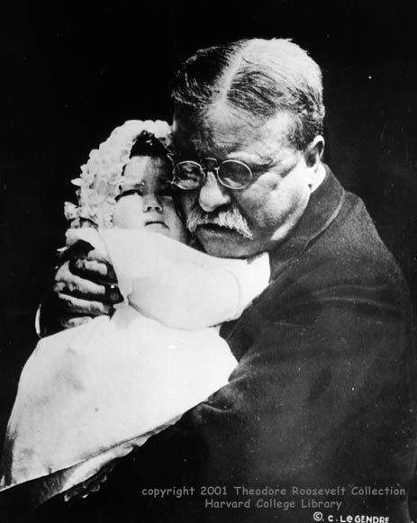 """TR learned of the death of his youngest son Quentin in July of 1918. Quentin, a fighter pilot for the US Army Air Corps in WW1, was shot down behind enemy lines.    """"Grandfather"""" Roosevelt hugs baby granddaughter Edith Roosevelt Derby, 1918."""