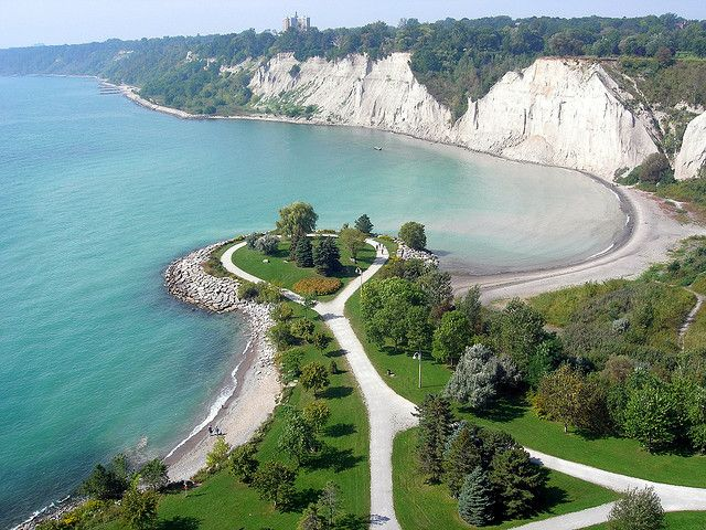 "Scarborough Bluffs - Forming much of the eastern portion of Toronto's waterfront, the Scarborough Bluffs has been described as a ""geological wonder"" and a unique feature in North America. The bluffs were named after Scarborough, England by Elizabeth Simcoe, the wife of John Graves Simcoe, the first lieutenant governor of Upper Canada. The bluffs run 14 kilometres from the foot of Victoria Park Avenue in the west to the mouth of Highland Creek in the east, reaching as high seventeen storeys."