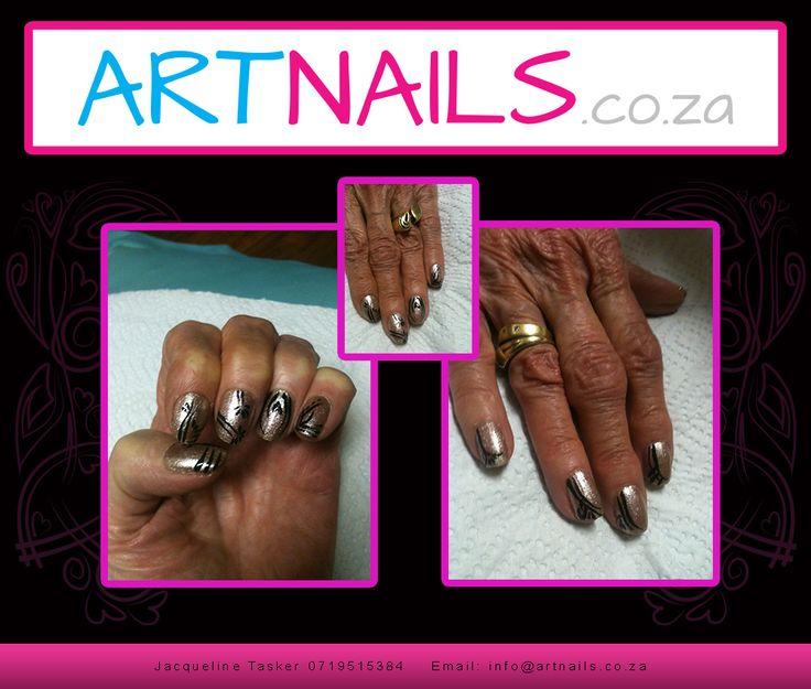 gold and black nail art acrylic overlay onto natural nails