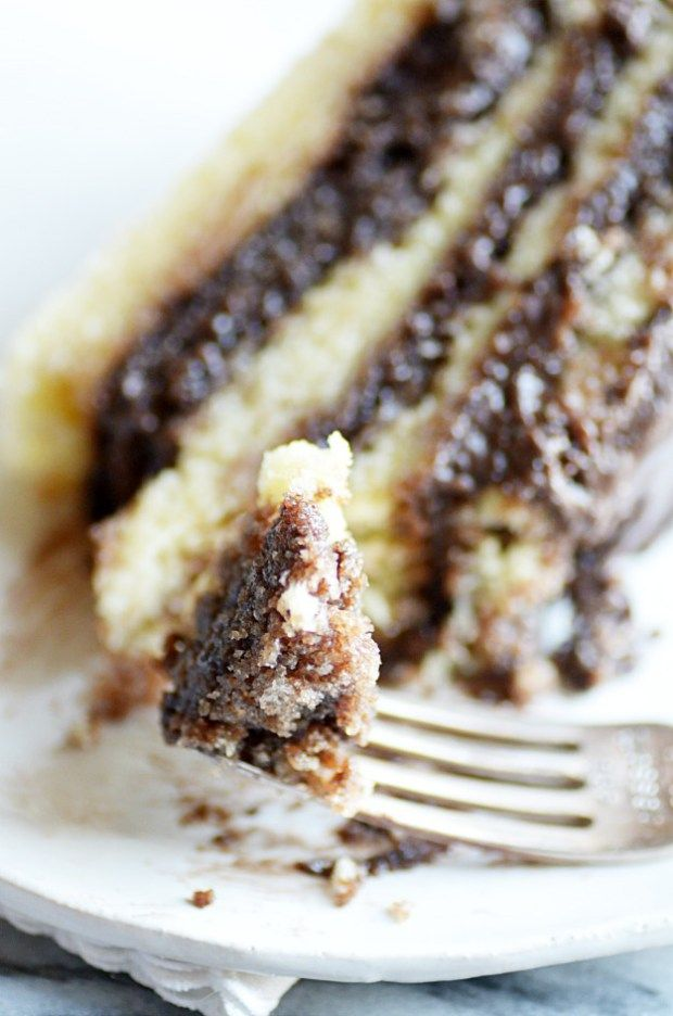 Layers of soft yellow cake soaking up rich, fudgy chocolate layers of my Grandma's famous chocolate frosting.