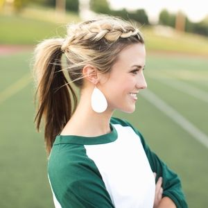 Braided Pony Tail accented with Leather Earrings. Sporty and chic.