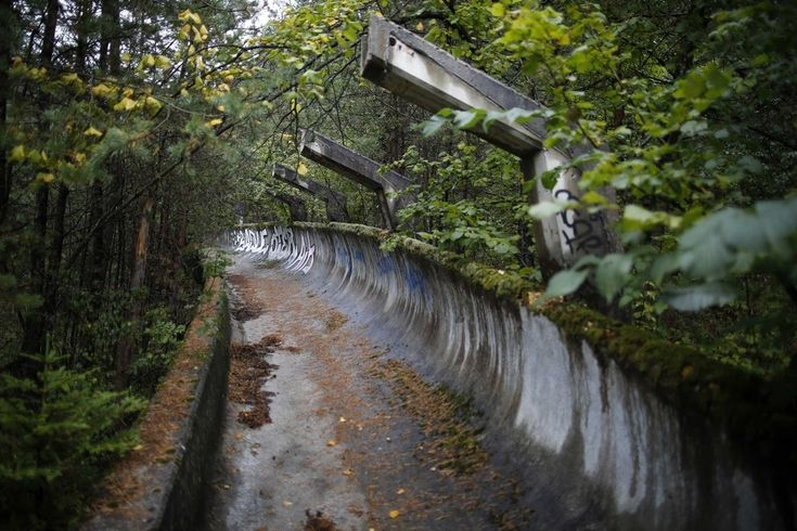 Up in the hills above the Bosnian capital is the Bobsleigh and Luge track used in the in 1984 Winter Olympics. | 19 Haunting Pictures Of The Abandoned 1984 Winter Olympics Venues