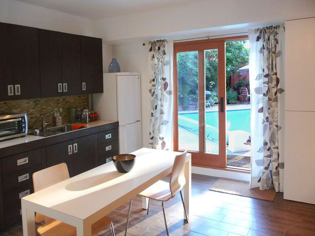 10 garage conversion ideas to improve your home sliding for Garage studio apartment