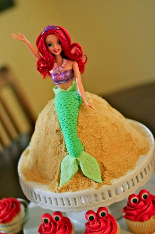 Princess Ariel Doll Cake | lissables.com Crab cupcakes are cute... not that I want red dye all over the place.