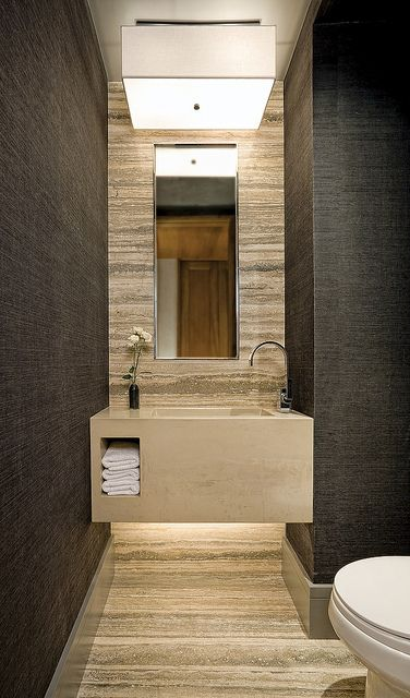 Stone by Louis W. Mian Love love love the light fixture as well as the wise inclusion of indirect lighting down below, else this bath could look like the entrance to a cave. Sumptuous wall treatment in a rich mocha against the cool tan of the stone, just perfect!