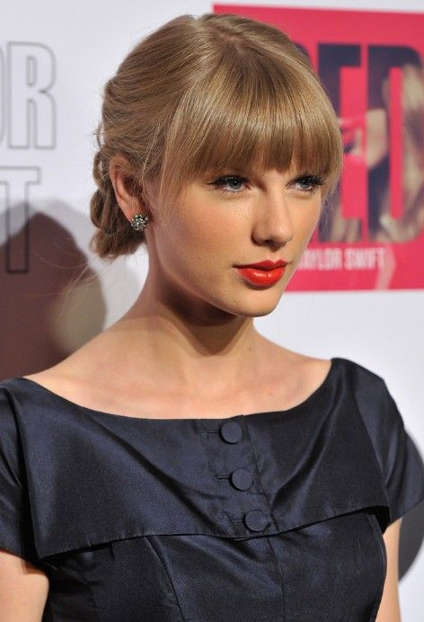 Taylor Swift Tucked-Under Braid with Blunt Bangs. Love this hair style