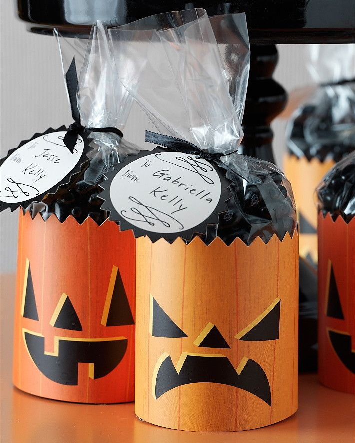 For these fast, festive party favors, wrap the printed paper sleeves around a bag of Halloween candy (like candy corn or orange and black jelly beans), tie with a ribbon, and add a personal tag.Buy Martha Stewart Crafts: Animal Masquerade Pumpkin Cello Treat Bags