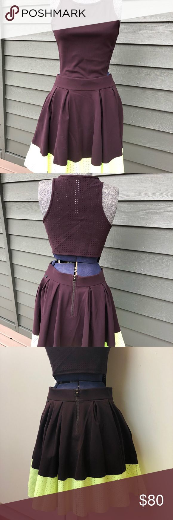 Lululemon dress Adorable NWOT, Lululemon Away dress with slight open back, pockets and fun details. Back and bottom are perforated. Different photos to show the color better. Eggplant with neon green bottom. lululemon athletica Dresses