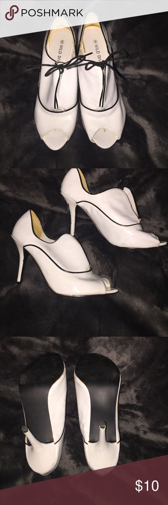 Wild diva black and white heels vintage gatsby Super cute patten leather shoes with black bows and trim. Gently used. Signs of wear shown in pics. Wild Diva Shoes Ankle Boots & Booties