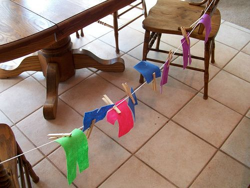 "This lady has posted a bunch of ""busy bag"" ideas. Little activities in a bag for toddlers to play with. I loved this little close line idea. Hanging clothes up to dry. The kid could even get them wet first...if you dare!"