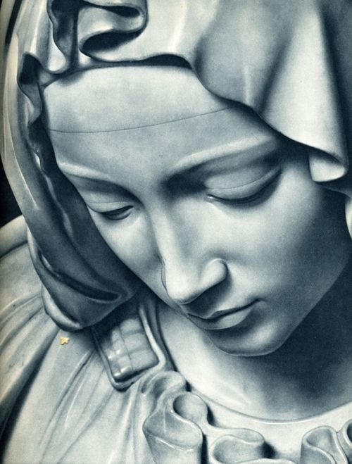 Detail of Pieta, sculpted by Michelangelo.