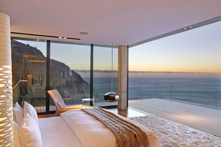 Ocean-front bedroom with a plush rug