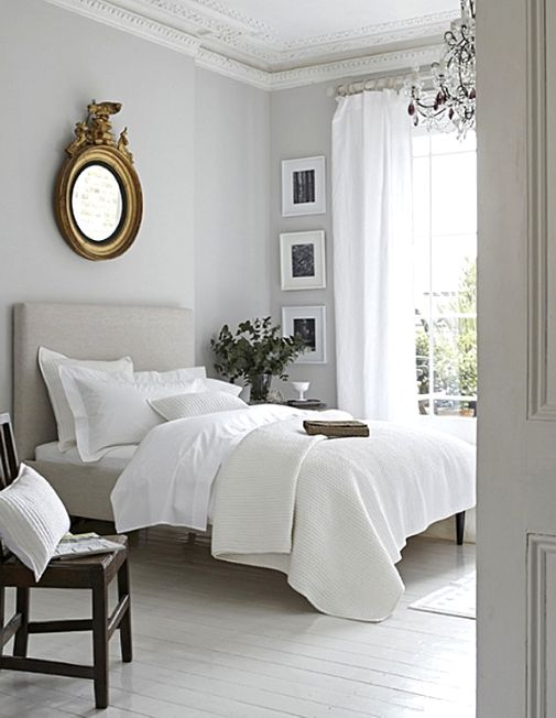 Classic grey white bedroom with gold accents