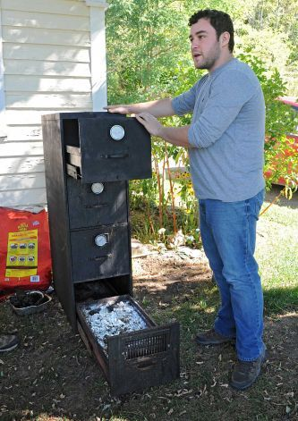 Bees Knees Cafe chef Rob Handel talks about a DIY file cabinet smoker he made at Heather Ridge Farm on Friday, Sept. 12, 2014 in Preston Hollow, N.Y. The cafe serves farm-to-table food. (Lori Van Buren / Times Union) Photo: Lori Van Buren / 00028534A