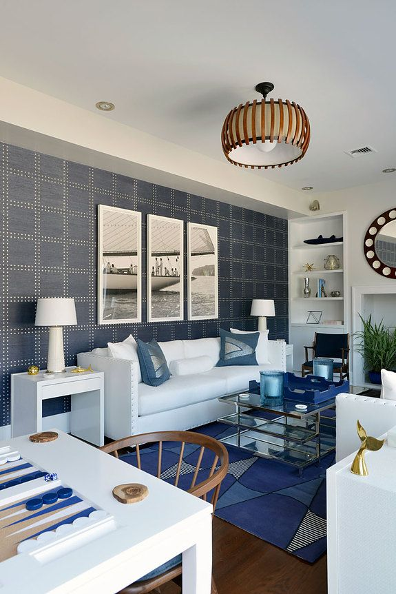 Design firm Mabley Handler Interior Design featured a custom designed Rivets Silver on Navy in the living room of a client's home.