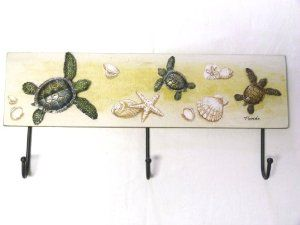 """Triple Hook - Three Raised Resin Sea Turtles on a Wood Back with Shell, Seashell Starfish and Sand Dollar Accent - Florida - 17.75"""" X 8"""" - 2 Key Hole Tabs on Back - Heavy Towels No Problem by Florida Gifts. $16.99. 2 Key Hole Tabs on Back. Three Raised Resin Sea Turtles on a Wood Back with Shell, Seashell Starfish and Sand Dollar Accent - Florida. Approximately 17.75"""" X 8"""". Triple Hook. Heavy Towels No Problem. Triple Hook.   Three Raised Resin Sea Turtles on a W..."""