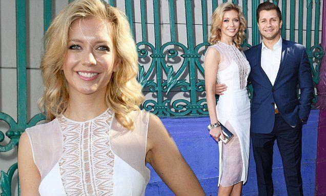 Rachel Riley sexy white dress at LFW with boyfriendPasha Kovalev