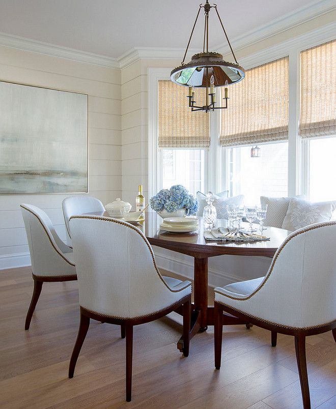 Elegant Breakfast Nook With Banquette And Beautiful White Dining Chairs
