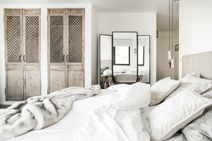 GoGalicia - Another view of Casa Minerva master bedroom with asian doors as wardrobes and beautiful iron mirror.