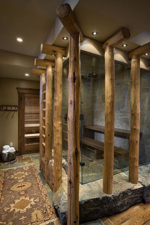 The Rough Hewn Granite And Hefty Logs Here Create A Grounding Environment In Which To Sit Back And Relax Eclectic Rustic Bathroom By Design Associates