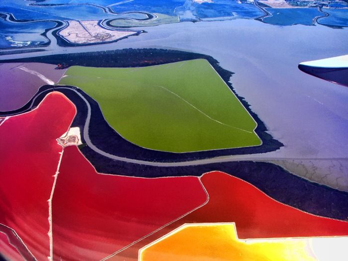 Multicolored Salt Ponds at San Francisco Bay If you ever fly over San Francisco Bay, be sure to peer out of the window to catch a glimpse of one of the world's most incredibly coloured landscapes - the salt evaporation ponds operated by Cargill, Inc. Salt evaporation ponds are shallow artificial ponds designed to produce salts from sea water or other brines. The seawater or brine i ...