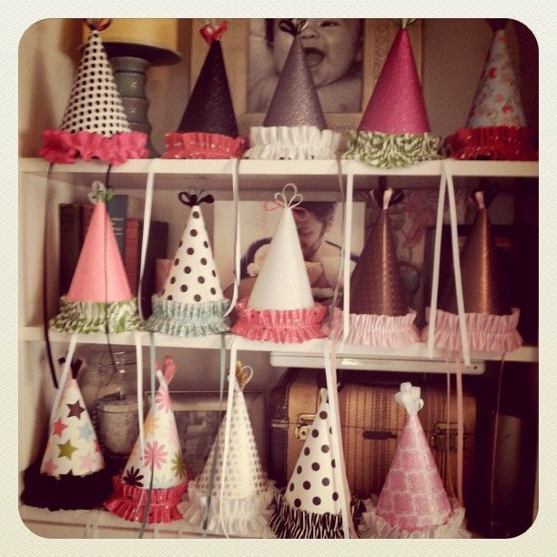 Party hats , made with glitter spray and cloth. Awesome!